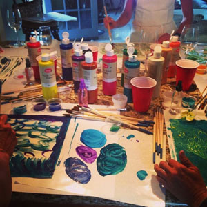 image of creativity workshop with painting supplies